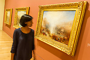 The three final works - The EY Exhibition: Late Turner – Painting Set Free - the first exhibition to survey Turner's final period of work (1835-51). From the age of 60 until his death. Highlights include: his 'radical' square oil paintings in recently restored frames - at the time of their creation, these works were his most controversial and were famously subjected to a hail of abuse in the press; Bamborough Castle c.1837 – an important work from a private collection which has only been displayed in public once in 125 years; Ancient Rome and Modern Rome c.1839 – brought together for the first time in a generation; and Turner's three final masterpieces shown in newly reconstructed frames (pictured): Mercury Sent to Admonish Aeneas, The Visit to the Tomb and The Departure of the Fleet c.1850. The show runs from 10 Sept to 25 January. Tate Britain, London, UK, 08 Sept 2014.
