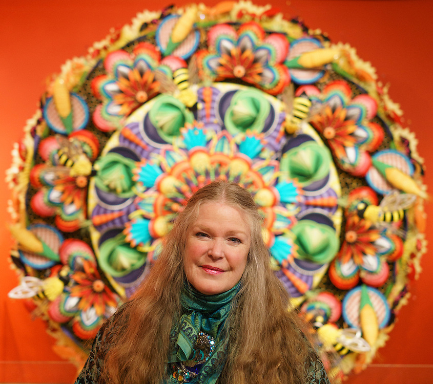 Baltimroe, Maryland - January 13, 2017: Rebecca Hoffberger, founder of the American Visionary Art Museum stands in front of artist Wendy Brackman's sculpture &quot;Brackman's Botanical Bonanza&quot; made of hand painted paper plates, straws, ping-pong balls, paper towel tubes.<br /> <br /> <br /> CREDIT: Matt Roth for The New York Times<br /> Assignment ID: 30201195A
