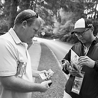 A couple of guys do business buying and selling tickets a few blocks from the entrance to the course.