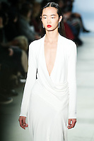 Huan Zhou walks the runway wearing Cushnie et Ochs Fall 2016, hair by Antonio Corral Calero for Moroccanoil, makeup by Val Garland, photographed by Thomas Concordia during New York Fashion Week on February 12, 2016