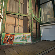 Storefront and old 7up sign in Colton, Washington.