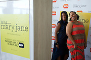 "Guests pose in the photo booth before a screening of BET's ""Being Mary Jane"" at the W Hotel in Dallas, Texas on June 22, 2013."