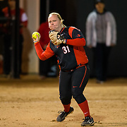 02 March 2018: San Diego State softball closes out day two of the San Diego Classic I at Aztec Softball Stadium with a night cap against CSU Northridge. San Diego State third baseman Molly Sturdivant (31) throws to first after fielding a ground ball in the second inning. The Aztecs dropped a close game 2-0 to the Matadors. <br /> More game action at sdsuaztecphotos.com