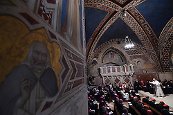 Pope Francis attends a meeting of prayer in the Basilica of St. Francis during the 30th World Day of Prayer for Peace a inter-religious meeting in the Italian pilgrimage town of Assisi, Italy on September 20, 2016. Pope Francis welcomed some 450 leaders representing a rainbow of faiths to the hilltop Italian town of Assisi to commemorate the 30th anniversary of a daylong prayer for peace here called by Pope John Paul II in 1986. Photo by Eric Vandeville/ABACAPRESS.COM