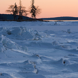 The frozen landscape of Mt. Desert Narrows in Maine's Acadia National Park. Sunset.