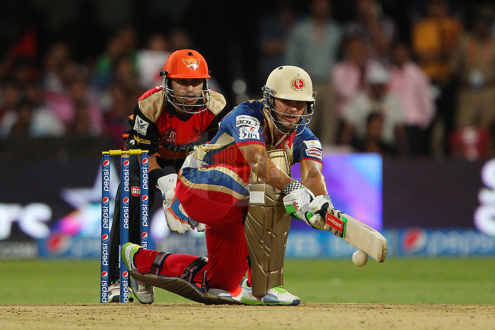 Rilee Rossouw of the Royal Challengers Bangalore looks to sweep but mis times his shot during match 24 of the Pepsi Indian Premier League Season 2014 between the Royal Challengers Bangalore and the Sunrisers Hyderabad held at the M. Chinnaswamy Stadium, Bangalore, India on the 4th May  2014<br /> <br /> Photo by Ron Gaunt / IPL / SPORTZPICS<br /> <br /> <br /> <br /> Image use subject to terms and conditions which can be found here:  http://sportzpics.photoshelter.com/gallery/Pepsi-IPL-Image-terms-and-conditions/G00004VW1IVJ.gB0/C0000TScjhBM6ikg