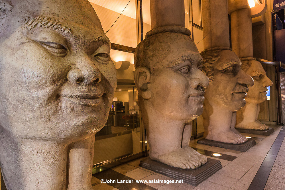 Faces at Dotonbori Hotel -The Dotonbori Hotel in Osaka welcomes guests with an amazing entrance featuring four huge columns with faces depicting the special qualities in human beings. The face columns act as a landmark and define the hotel's unique architecture.