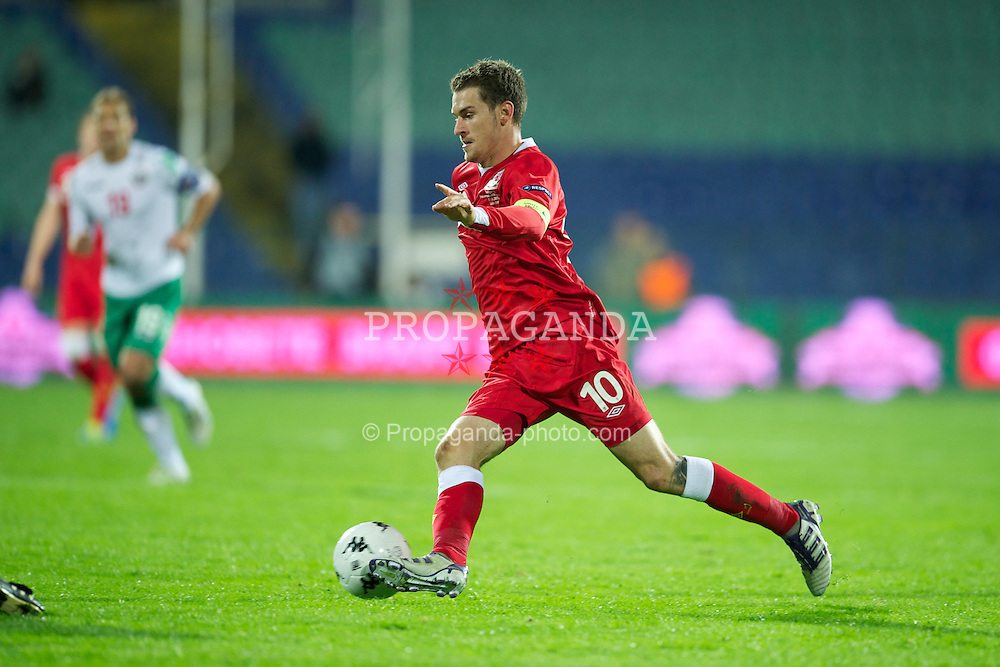 SOFIA, BULGARIA - Tuesday, October 11, 2011: Wales' captain Aaron Ramsey in action against Bulgaria during the UEFA Euro 2012 Qualifying Group G match at the Vasil Levski National Stadium. (Pic by David Rawcliffe/Propaganda)