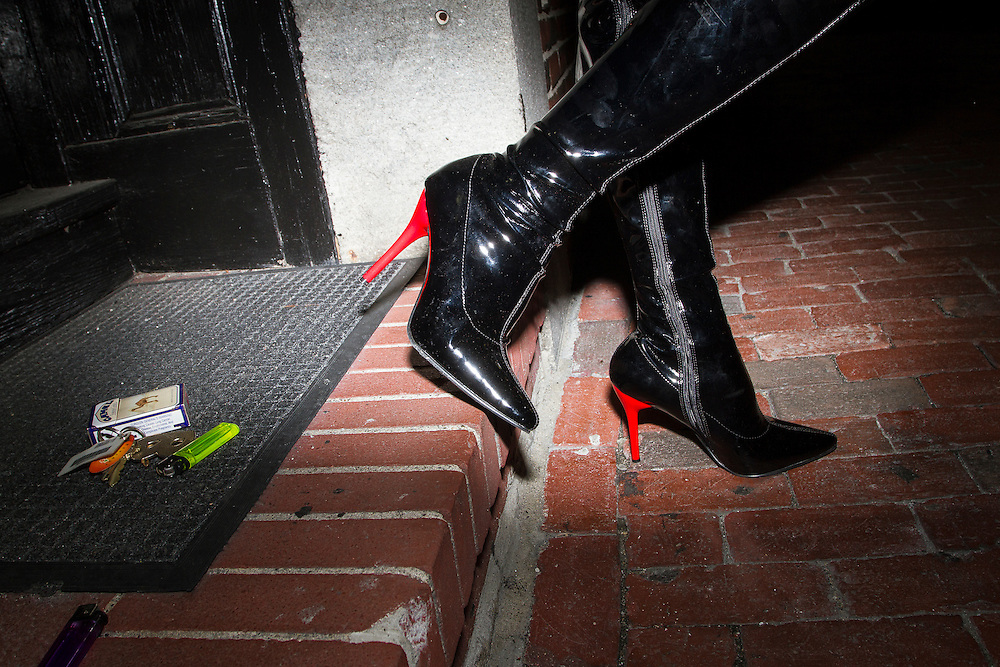 Red heels boots, a pack od cigarette and a set of keys outside of Jacques Cabaret in Bay Village neighborhood of Boston, MA USA on September 16, 2012.<br /> Jacques Cabaret (EST: 1931) is the oldest drag queen live cabaret in Boston, MA USA.