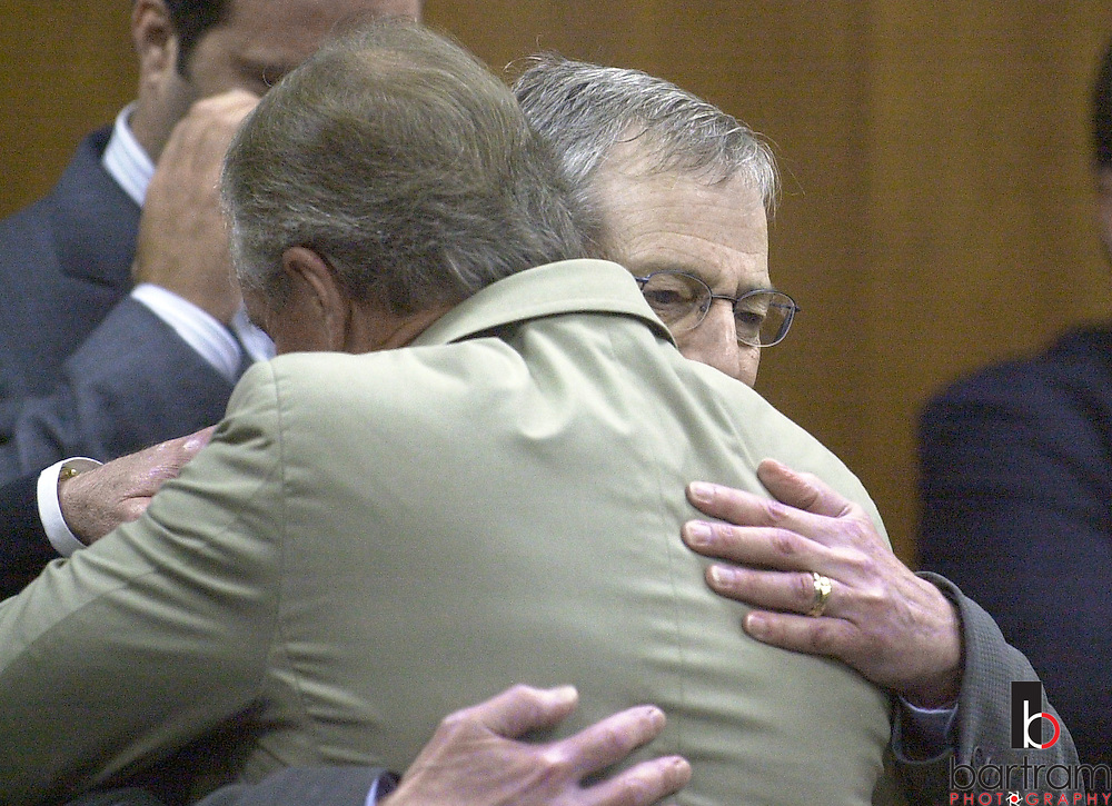 Robert Durst, right, hugs defense attorney Dick DeGuerin after durst was found not guilty on Tuesday, November 11, 2003.