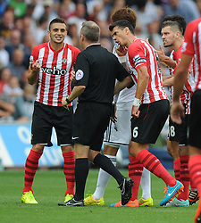 Southampton's José Fonte confronts the referee about his yellow card. - Photo mandatory by-line: Alex James/JMP - Mobile: 07966 386802 20/09/2014 - SPORT - FOOTBALL - Swansea - Liberty Stadium - Swansea City v Southampton  - Barclays Premier League