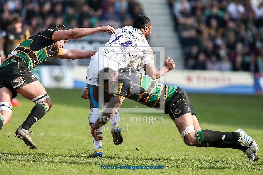 Vereniki Goneva of Leicester Tigers (centre)  is tackled by Courtney Lawes of Northampton Saints (right) during the Aviva Premiership match at Franklin's Gardens, Northampton<br /> Picture by Andy Kearns/Focus Images Ltd 0781 864 4264<br /> 29/03/2014