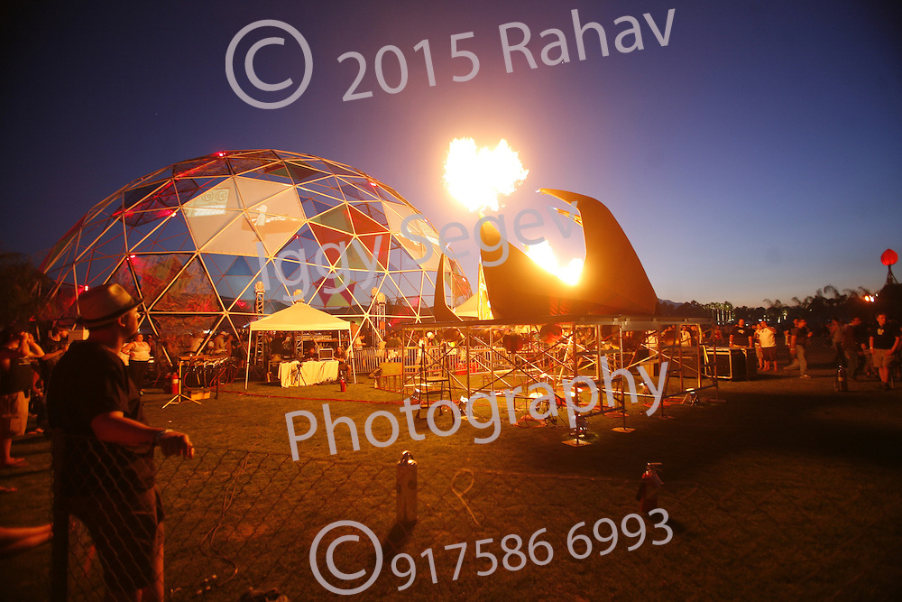 "An Art installatiion at the  Coachella Valley Music and Arts Festival at the Empire Polo Fields  2007 in Indio California on April 29, 2007. ..This shot shows Mark Tomkiewicz's ""Fire Pod""  with on of the Geodesic domes on the site."