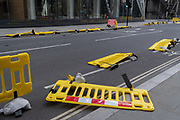 As Storm Ellen hits the capital, social distancing barriers placed along Leadenhall in the City of London, have been blown over in strong winds as gusts reached the financial district, on 21st August 2020, in London, England.