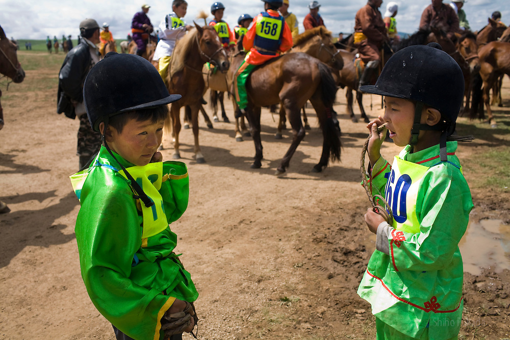 Mongolia - Edward Wong - Horse Race<br /> <br /> Boy jockeys are seen before the horse race in Khui Doloon Khudag, Mongolia, July 10, 2008. Participants of this weekend's horse race during Naadam festival gather the area to practce. Children from 5 to 13 are chosen as jockeys. Photo by Shiho Fukada for The New York Times