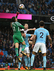 Manchester City goalkeeper Ederson punches the ball clear from Burnley's Ashley Barnes during the Premier League match at the Etihad Stadium, Manchester.