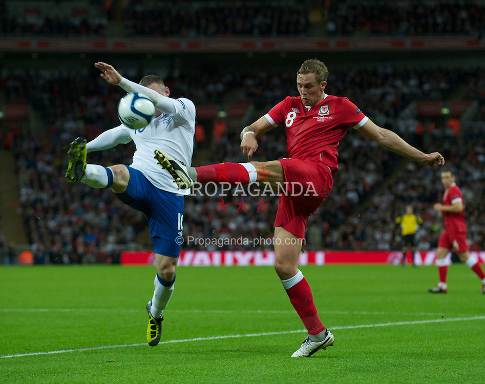 LONDON, ENGLAND - Tuesday, September 6, 2011: Wales' Jack Collison and England's Wayne Rooney during the UEFA Euro 2012 Qualifying Group G match at Wembley Stadium. (Pic by Gareth Davies/Propaganda)