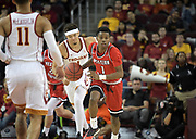 Western Kentucky Hilltoppers guard Lamonte Bearden (1) dribbles the ball against the Southern California Trojans during an NCAA college basketball game in the second round of the NIT tournament in Los Angeles, Monday, Mar 19, 2018. WKU defeated USC 79-75.