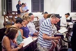 Members of  St. Thomas Synagogue observe Kol Nidre, opening of the Day of Atonement service on the eve of Yom Kippur.  St. Thomas Synagogue.  22 September 2015.  St. Thomas, USVI.  © Aisha-Zakiya Boyd