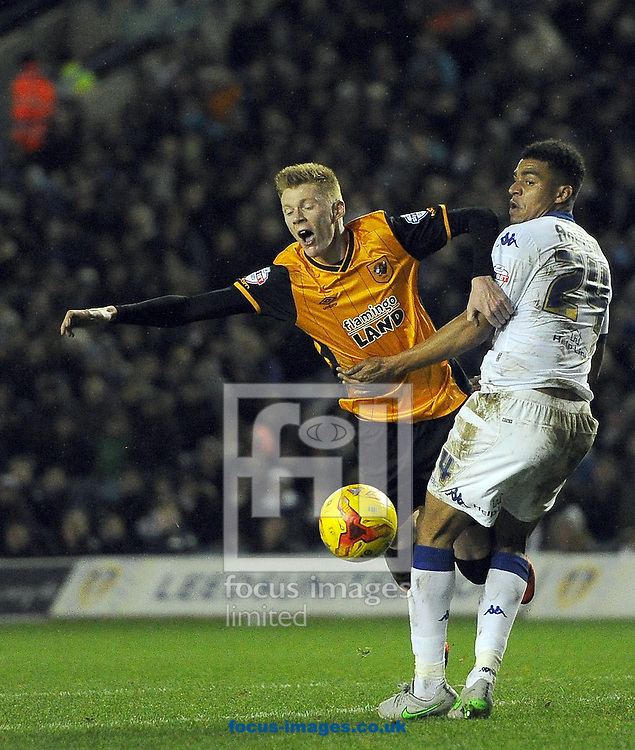 Sam Clucas of Hull City feels the challange from Tom Adeymi of Leeds United during the Sky Bet Championship match at Elland Road, Leeds<br /> Picture by Graham Crowther/Focus Images Ltd +44 7763 140036<br /> 05/12/2015