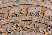 Ornate carvings of horses and elephants in steps, Sacred Quadrangle, Ruins of ancient city, Polonnaruwa, Sri Lanka.