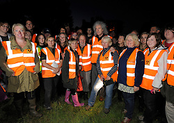 © Licensed to London News Pictures. 06/09/2013. Eldersfield, Gloucestershire, UK.  Brian May with campaigners on the Wounded Badger Patrol when he visited the badger culling zone in West Gloucestershire to lend support to the campaign against the cull.  Brian is an outspoken opponent of the badger cull and has a charity called Save Me.  The Government has licensed a pilot badger cull as part of efforts to reduce boving turberculosis in cows on farms.  06 September 2013.<br /> Photo credit : Simon Chapman/LNP