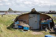 Upturned boats used as storage shed, Holy Island, Lindisfarne, Northumberland, England, UK