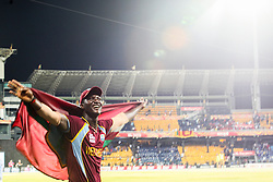 © Licensed to London News Pictures. 07/10/2012. West Indian captain Darren Sammy holding the West Indian flag during the lap of honour during the World T20 Cricket Mens Final match between Sri Lanka Vs West Indies at the R Premadasa International Cricket Stadium, Colombo. Photo credit : Asanka Brendon Ratnayake/LNP