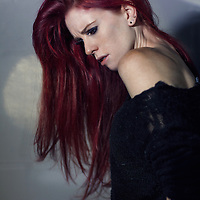 Young redhead looking lonely with long hair