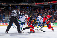 PENTICTON, CANADA - SEPTEMBER 10: Hunter Smith #71 of Calgary Flames checks Jonah Gadjovich #43 of Vancouver Canucks at the face off on September 10, 2017 at the South Okanagan Event Centre in Penticton, British Columbia, Canada.  (Photo by Marissa Baecker/Shoot the Breeze)  *** Local Caption ***