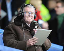 John Motson commentates on the match at Fratton Park after earlier signing copies of his autobiography in the club shop. Portsmouth v Manchester United (1-4), Barclays Premier League Fratton Park, Portsmouth, 28th November 2009.