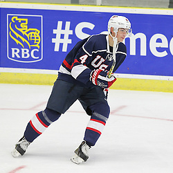 COBOURG, - Dec 16, 2015 -  Game #7 - United States vs Switzerland at the 2015 World Junior A Challenge at the Cobourg Community Centre, ON. John Marino #4 of Team United States follows the play during the first period.(Photo: Tim Bates / OJHL Images)