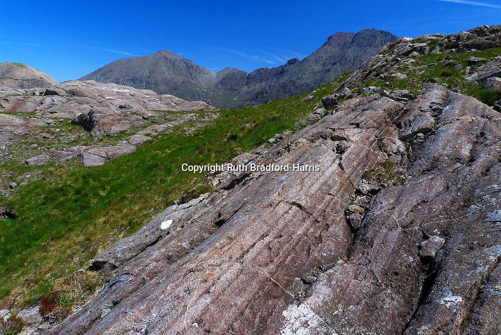 The summit of the spectacular, glacially-sculpted ridge of Druim Hain (Druim an Eidhne), Isle of Skye, whose fabulously laminated Bytownite Gabbro (Eucrite), spherulitic Rhyolite and intrusion breccias have excited geologists for generations.<br />