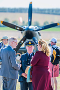 Peopel in period costumes on the Flight line - Duxford Battle of Britain Air Show at the Imperial War Museum. Also commemorating the 50th anniversary of the 1969 Battle of Britain film. It runs on Saturday 21 & Sunday 22 September 2019