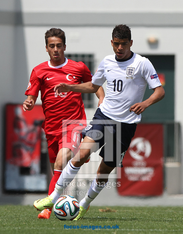 Dominic Solanke (right) of England takes the ball away from Emirhan Aydoğan (left) of Turkey during the 2014 UEFA European Under-17 match at Gozo Stadium, Xewkija<br /> Picture by Tom Smith/Focus Images Ltd 07545141164<br /> 12/05/2014