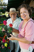 Senior Couple Shopping for flowers at plant nursery portrait