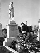 01/02/1959<br /> 02/01/1959<br /> 01 February 1959<br /> Liam Whelan's grave at Glasnevin, Dublin.  Mrs Elizebeth Whelan (left), mother of Liam Whelan of Manchester United, killed in the Munich Air Disaster on 6th February 1958, watches as her daughter Maura, a younger sister of Liam, places fresh flowers on the grave during their weekly visit.