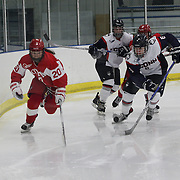 Samantha Sutherland, (left), Boston University and Nora Maclaine, UConn, challenge for the puck during the UConn Vs Boston University, Women's Ice Hockey game at Mark Edward Freitas Ice Forum, Storrs, Connecticut, USA. 5th December 2015. Photo Tim Clayton
