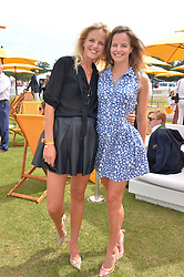 Left to right, sisters JENNY DAWSON and ALICE DAWSON at the Veuve Clicquot Gold Cup Final at Cowdray Park Polo Club, Midhurst, West Sussex on 20th July 2014.
