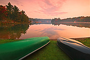 canoes on beach at George Lake at dawn<br />