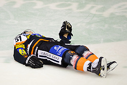10.01.2012, Eisstadion Liebenau, Graz, AUT, EBEL, Graz 99ers vs EHC Linz, im Bild Daniel Woger, (99ers, #51) nach einem schweren Check am Boden // during the ice hockey game between Graz 99ers and EHC Linz at the Eisstadion Liebenau, Graz, Austria, 2012/01/10, EXPA Pictures © 2011, PhotoCredit: EXPA/ S. Zangrando