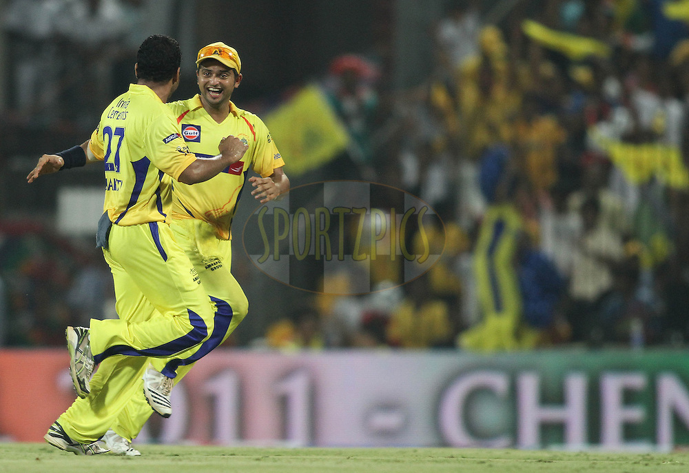 Shadab Jakati of the Chennai Super Kings celebrates with Suresh Raina of the Chennai Super Kings after getting AB De Villiers of the Royal Challengers Bangalore wicket during the final of the Indian Premier League ( IPL ) Season 4 between the Chennai Superkings and the Royal Challengers Bangalore held at the MA Chidambaram Stadium in Chennai, Tamil Nadu, India on the 28th April 2011..Photo by Shaun Roy/BCCI/SPORTZPICS