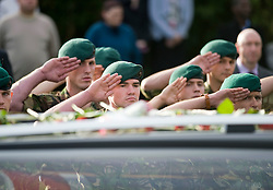 © licensed to London News Pictures. 08/09/2011. Brize Norton, UK..Members of 42 Commando Royal Marines watch the Body of Sergeant Barry Weston of 42 Commando Royal Marines passes the memorial in Carterton after arriving at RAF Brize Norton for the first time. Sgt Weston was killed on August 30 while leading a patrol near the village of Sukmanda in southern Nahr-e Saraj, Helmand province. Photo credit: Ben Cawthra/LNP