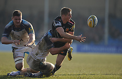 Gareth Steenson of Exeter Chiefs passes the ball after being tacked by Mark Wilson of Newcastle Falcons.  - Mandatory byline: Alex Davidson/JMP - 12/03/2016 - RUGBY - Sandy Park -Exeter Chiefs,England - Exeter Chiefs v Newcastle Falcons - Aviva Premiership