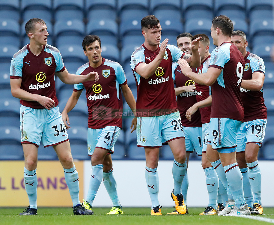 Burnley's Sam Vokes (right) celebrates scoring his side's second goal of the game with teammates during the pre-season friendly match at Deepdale, Preston.