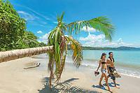 Couple strolls beach near Punta Uva, Costa Rica. Copyright 2017 Reid McNally.