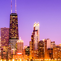 Panorama photo of Chicago skyline by night with the Hancock building and other downtown Chicago city buildings. The John Hancock Center building is one of the tallest buildings in the United States. Panorama photo ratio is 1:3.