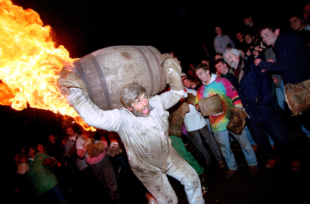 With a barrel freshly enhanced by a boost of paraffin, the experienced barrel man begins to do his job and frighten the crowd.