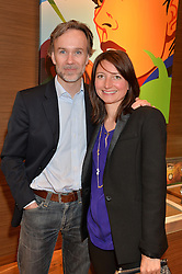 MARCUS WAREING and his wife JANE at a party to celebrate the 30th Anniversary of the Breitling Chronomat held at 130 Breitling, New Bond Street, London on 7th May 2014.