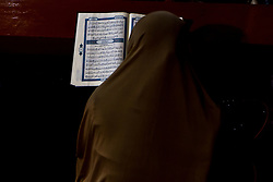 May 30, 2017 - Central Jakarta, Jakarta, Indonesia - A Muslim woman reads the Quran following noon prayers on the fourth day of the holy fasting month of Ramadan at Istiqlal Mosque in Jakarta, Indonesia on May 30, 2017. During Ramadan, the holiest month on Islamic calendar, Muslims refrain from eating, drinking, smoking and sex from dawn to dusk. (Credit Image: © Afriadi Hikmal via ZUMA Wire)